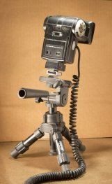 Mini tripod for holding the flash in macro photography lighting set-up