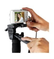 Point and shoot camera mounted on a monopod with a handle