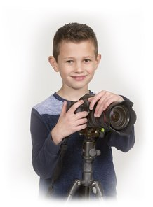 A DSLR camera is simply too big for a 7 year old to use without a tripod.