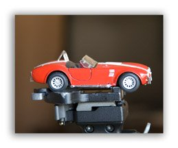 Red Car and Small Depth of Field Gives a Blurry Background