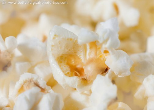 Close-up photo of popcorn with a single window light and one piece of white cardboard for bounce fill