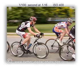 A slower shuttere speed can give you just the rgiht amount of background motion blur behind the racing cyclists