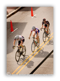 Try to find a high angle to shoot down at the racing cyclists