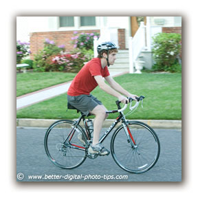 Example of Blurry Background From Background Motion - Bike Rider 1/125 Second
