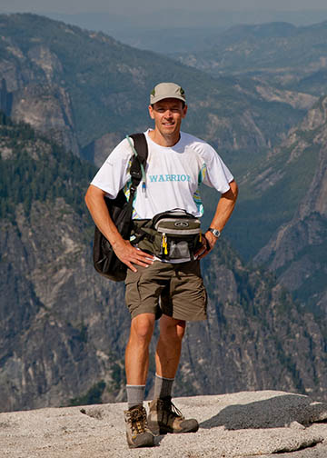 Traveling photographer on Half Dome