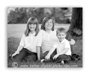 Pre-visualize how they clothing, lighting and background will look as a black and white family portrait