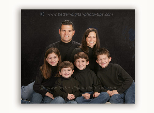 Family portrait of 6 posed people