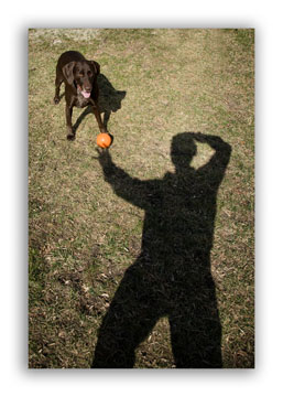 Self portrait with dog and ball - using the rule of thirds
