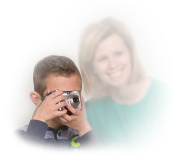 Boy with digital camera and mom