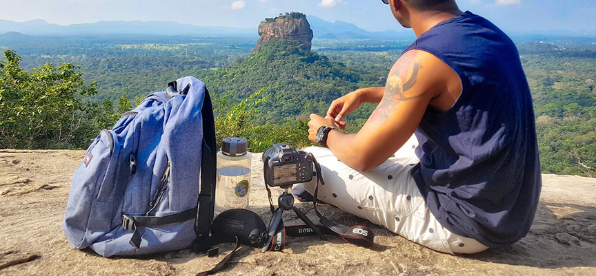 Hiker with camera backpack