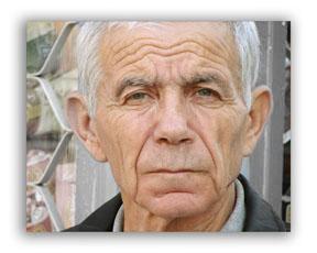 Distracting background removed on senior citizen portrait