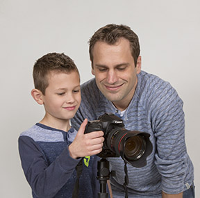 Feather and son learning photography together