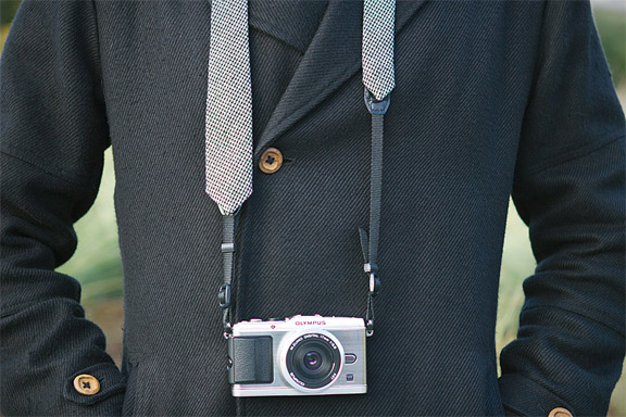 camera support with fashion necktie and camera strap