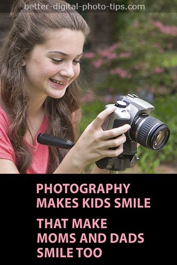 Smiling child photographer