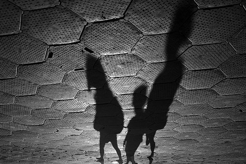 Shadow photo of 3 children