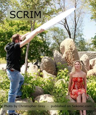 Blocking harsh overhead light with a scrim