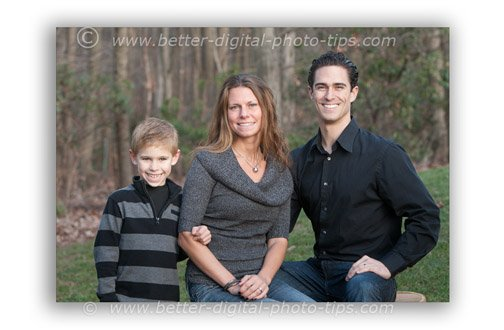 Small family of 3 photographed in the shade of their backyard