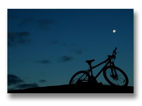 Photographing the Moon behind a Parked Bicycle