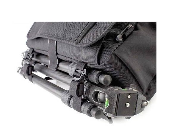 You can mount your trpod underneath a shoulder camera bag