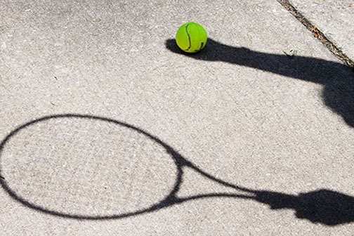 Shadowed tennis player