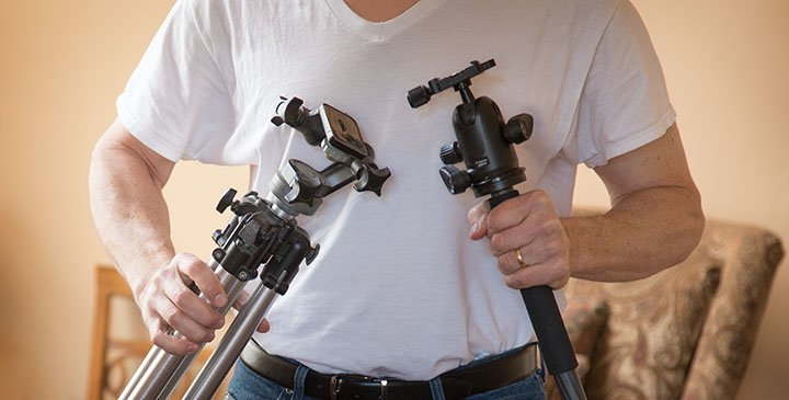 monopod and tripod in hands