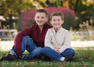 Outdoor portrait of two boys in the shade with fill light bounced from a white reflector board.