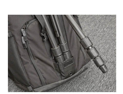 Two tripod legs fit into the tripod pouch on my Tamrac backpack